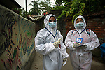 Sweta (L) and Nilima (R) work on contract basis as health worker at Kolkata Municipal Corporation (Health department). They are now going from house to house to check for fever at a slum area in Kolkata midst the 2nd phase of lockdown in India due to covid 19 pandemic. This is to curb the spread of Covid 19 in the country. The second phase is handled with more strict rules by the administration. Kolkata, West Bengal, India. Arindam Mukherjee.
