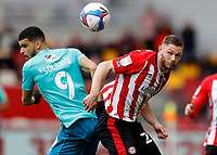 22nd May 2021; Brentford Community Stadium, London, England; English Football League Championship Football, Playoff, Brentford FC versus Bournemouth; Henrik Dalsgaard of Brentford heads the ball out past Dominic Solanke of Bournemouth