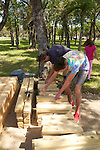 Volunteers building lots and lots of wooden benches