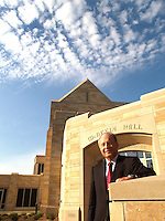 Dean of the college of business at St. Thomas U, Chris Puto poses outside newly completed McNeely Hall. Photo by Brad Stauffer