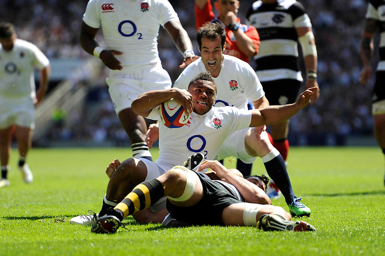 Kyle Eastmond of England enjoys scoring on his debut during the match between England and Barbarians at Twickenham on Sunday 26th May 2013 (Photo by Rob Munro)