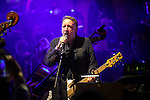 """© Joel Goodman - 07973 332324 . 05/02/2016 . Manchester , UK . PETER HOOK . """" Hacienda Classical """" debut at the Bridgewater Hall . The 70 piece Manchester Camerata and performers including New Order's Peter Hook , Shaun Ryder , Rowetta Idah , Bez and Hacienda DJs Graeme Park and Mike Pickering mixing live compositions . Photo credit : Joel Goodman"""