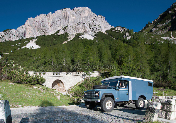 Land Rover Series 2a Ambulance based Defender 110 300tdi camper van passing the cobblestoned bend 23 of the Vrsic mountain pass from Kranjska Gora to Bovec in the Julian Alps, Slovenia. --- No releases available, but releases may not be necessary for certain uses. Automotive trademarks are the property of the trademark holder, authorization may be needed for some uses.