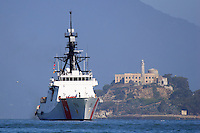 The United States Coast Guard Cutter Bertholf (WMSL 750) passes by Alcatraz Island in San Francisco Bay on its way to its new home port in Alameda, California. The Bertholf was launched on September 29, 2006 at the Ingalls Shipyard in Pascagoula, Mississippi and was christened on November 11, 2006. It is the first of the Legend class maritime security cutters to enter the Coast Guard fleet. Photographed 7/23/08