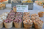 Vegetable stand.Onions by the bushel
