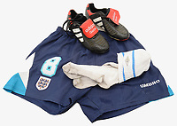 BNPS.co.uk (01202) 558833<br /> Pic: CatherineSouthon/BNPS<br /> <br /> Paul Gascoigne's shorts, socks and boots from Euro 96 have sold for £5,000 following a bidding war as football fever grips the nation.<br /> <br /> The England footballer wore the unwashed blue Umbro shorts and white socks in the classic 4-1 win over Holland at Wembley.<br /> <br /> They were auctioned off alongside his Adidas Predator boots with 'Gazza' embroidered on the tongue which were in his kitbag that day.<br /> <br /> England went on to lose the semi final of the tournament against Germany after current manager Gareth Southgate missed a penalty in the shootout.