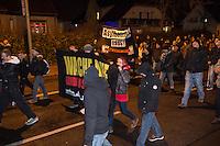 """Am Montag den 24. November 2014 demonstrierten ca. 700 Neonazis, Hooligans, NPD-Mitglieder und Mitglieder der Neonazipartei """"Die Rechte"""", sowie eine sog. """"Buegerbewegung Hellersdorf"""" in Berlin Marzahn-Hellersdorf mit einer """"Montagsdemo"""" gegen eine geplante Unterkunft fuer Fluechtlinge.<br /> Die Demonstrationsteilnehmer bruellten aggresiv Parolen gegen Fluechtlinge, die geplante Unterkunft - """"Nein zum Heim"""" und die anwesenden Journalisten - """"Deutsche Presse auf die Fresse!"""". Aus der Demonstration heraus wurden Journalisten bespuckt und geschlagen. Etliche Teilnehmer trugen sog. """"passive Bewaffnung"""" (Helme) und waren vermummt.<br /> Die mit mehreren hundert Beamten anwesende Polizei schritt nicht ein.<br /> Gegen den rechten Aufmarsch protestierten 150 Personen.<br /> 24.11.2014, Berlin<br /> Copyright: Christian-Ditsch.de<br /> [Inhaltsveraendernde Manipulation des Fotos nur nach ausdruecklicher Genehmigung des Fotografen. Vereinbarungen ueber Abtretung von Persoenlichkeitsrechten/Model Release der abgebildeten Person/Personen liegen nicht vor. NO MODEL RELEASE! Nur fuer Redaktionelle Zwecke. Don't publish without copyright Christian-Ditsch.de, Veroeffentlichung nur mit Fotografennennung, sowie gegen Honorar, MwSt. und Beleg. Konto: I N G - D i B a, IBAN DE58500105175400192269, BIC INGDDEFFXXX, Kontakt: post@christian-ditsch.de<br /> Bei der Bearbeitung der Dateiinformationen darf die Urheberkennzeichnung in den EXIF- und  IPTC-Daten nicht entfernt werden, diese sind in digitalen Medien nach §95c UrhG rechtlich geschuetzt. Der Urhebervermerk wird gemaess §13 UrhG verlangt.]"""
