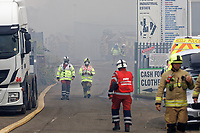Pictured: Fire service personnel. Monday 21 June 2021<br /> Re: Fire at a unit at Players Industrial Estate in the Clydach area of Swansea, Wales, UK.
