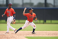GCL Astros shortstop Sean Mendoza (3) throws to first base as second baseman Dexter Jordan (12) looks on during a Gulf Coast League game against the GCL Mets on August 10, 2019 at FITTEAM Ballpark of the Palm Beaches Training Complex in Palm Beach, Florida.  GCL Astros defeated the GCL Mets 8-6.  (Mike Janes/Four Seam Images)