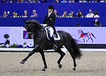 OMAHA, NEBRASKA - APR 1: Edward Gal rides Glock's Voice during the FEI World Cup Dressage Final II at the CenturyLink Center on April 1, 2017 in Omaha, Nebraska. (Photo by Taylor Pence/Eclipse Sportswire/Getty Images)