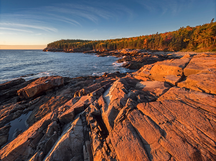 Sunrise clouds along the eastern coastline of Great Head in Acadia National Park, Maine, USA