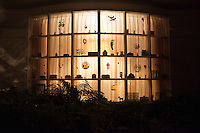 Glass works and trinkets glow in the evening in the window of a  residence on Bestor Plaza in Chautauqua Institution. Chautauqua, NY. June 26, 2014. Photo By Brendan Bannon.