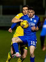 5th April 2021; Palmerston Park, Dumfries, Scotland; Scottish Cup Third Round, Queen of the South versus Hibernian; Paul Hanlon of Hibernian gets a grip on Connor Shields of QOTS