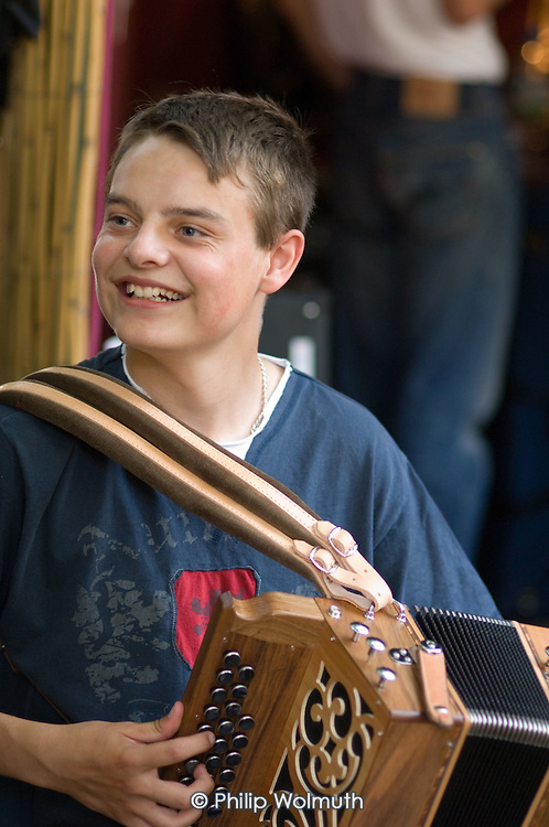 A young musician plays a diatonic accordion at the 31st International Festival of Luthiers and Maitres Sonneurs, in Saint Chartier, France.