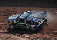 Dec. 10, 2011; Chandler, AZ, USA;  LOORRS pro 4 unlimited driver Johnny Greaves (12) and Todd LeDuc (4) during round 15 at Firebird International Raceway. Mandatory Credit: Mark J. Rebilas-