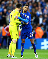 Lukasz Fabianski of Swansea City and Riyad Mahrez of Leicester City shake hands at full time during the Barclays Premier League match between Leicester City and Swansea City played at The King Power Stadium, Leicester on 24th April 2016