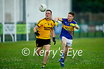 Glenflesks Cian Horan puts in a tackle for possession on Emmets Tom McCarthy in the Div 3 of the County football league