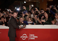 """British actor Ralph Fiennes signs autographs on the red carpet as he arrives for a special screening of the movie """"The English Patient"""" during the international Rome Film Festival at Rome's Auditorium, 22 October 2016. The Film Festival celebrates one of the most beloved of Cinema History 'The English Patient' by Anthony Minghella, released twenty years ago (in 1996). <br /> UPDATE IMAGES PRESS/Isabella Bonotto"""