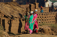 These women carry some 12 bricks each on a small construction site on the road from Mumbai to Goa about 3 hours from Mumbai,India