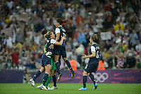 London, England - Thursday, August 9, 2012: The USA defeated Japan 2-1 to win the London 2012 Olympic gold medal at Wembley Arena. Shannon Boxx celebrates with Christie Rampone and Hope Solo.