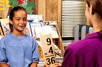 Ethnis hispanic student grade 3 learning math with mathematics flash card