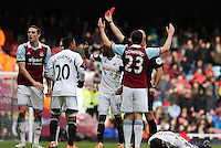 Pictured: Chico Flores of Swansea on the ground after the header challenge against Andy Carroll (L) of West Ham which resulted in the former seeing a red card by match referee Howard Webb. 01 February 2014<br />