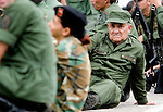 Members of the Venezuelan National Reserve rest during practice session for a military parade in Fuerte Tiuna, a military facility in Caracas, Venezuela, on Saturday, Jun. 17, 2006. (ALTERPHOTOS/Alvaro Hernandez)