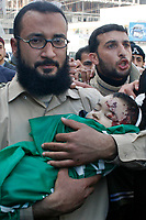 "Palestinian father of Mohammad Al-bourai  6-month-old carry his sun  throw whis funeral in Gaza February 28, 2008. Al-Borai was killed after Israeli military aircraft bombed the Hamas-run Interior Ministry in Gaza city on Wednesday, hospital officials said.""photo by Fady Adwan"""