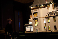 A visitor looks at a model of the Villa Lumiere at the Institut Lumiere, Lyon, France, 13 January 2012