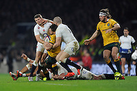 Adam Ashley-Cooper of Australia is tackled by Richard Wigglesworth and Mike Brown of England during the QBE International match between England and Australia at Twickenham Stadium on Saturday 29th November 2014 (Photo by Rob Munro)