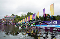 04 AUG 2012 - LONDON, GBR - Competitors dive into the water at the start of the swim at the women's London 2012 Olympic Games Triathlon in Hyde Park, London, Great Britain .(PHOTO (C) 2012 NIGEL FARROW)