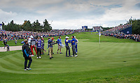 28.09.2014. Gleneagles, Auchterarder, Perthshire, Scotland.  Rory McIlroy (EUR) congratulates Graeme McDowell (EUR) after his win over Jordan Spieth [USA] to get the second point of the day.  Team Europe won the trophy sixteen and a half points to eleven and a half.