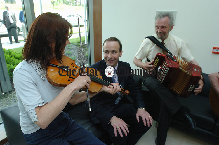 Minister Micheal Martin meets Clare musicians Anne Marie Mc Cormack and Michael Butler at the official opening of the new Information Age park at the Gort Road, Ennis on Thursday last. Photograph by John Kelly.