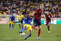 Gabriel Achilier (18) of Ecuador and Brek Shea (11) of the United States. The men's national team of the United States (USA) was defeated by Ecuador (ECU) 1-0 during an international friendly at Red Bull Arena in Harrison, NJ, on October 11, 2011.