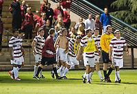 STANFORD, CA - September 12, 2012: Stanford midfielder Austin Meyer (17) and teammates celebrate his game winning goal during the during the Stanford vs San Jose St. men's soccer match in Stanford, California. Final score, Stanford 2, San Jose St. 1 in overtime.