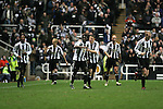 Newcastle United 2 Watford 1, 16/12/2006. St James Park, Premier League. Newcastle United take on Watford (yellow shirts) in a Premiership match at St. James' Park, Newcastle. Both teams were struggling near the bottom of the table with the newly-promoted visitors occupying one of the three relegation at the time of the match. Newcastle won by 2 goals to 1, both being scored by Obafemi Martins. Hameur Bouazza had equalised before United's late winner. Photo shows United players celebrating the winning goal. Photo by Colin McPherson.