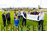 Nathan Walsh and Gerry Lynch presenting €1,800 to Fergal Grimes, General Manager of UHK.<br /> Back l to r: Jennifer and John Lynch, Sharon Walsh, Cian Lynch, Jamie Cleary Lynch, Gerry,  Emma, David and Michael Lynch and Margaret O'Callaghan.