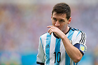 Lionel Messi of Argentina wipes his mouth