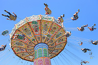 People enjoy the Wave Swinger at the Ohio State Fair in Columbus, Ohio.