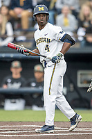 Michigan Wolverines second baseman Ako Thomas (4) walks to the plate against the Maryland Terrapins on April 13, 2018 in a Big Ten NCAA baseball game at Ray Fisher Stadium in Ann Arbor, Michigan. Michigan defeated Maryland 10-4. (Andrew Woolley/Four Seam Images)