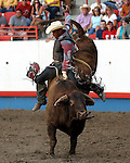 Mike Moore scores an 83 point ride on Beutler & Son Rodeo Company bull Deputy Sheriff to tie in the round with Souli Shanklin on July 29th at the Greeley Independence Stampede Rodeo in Greeley, Colorado.