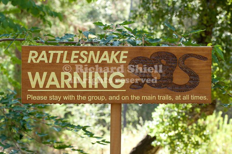 RATTLESNAKE WARNING SIGN AT QUARRYHILL BOTANIC GARDEN, SONOMA, CALIFORNIA
