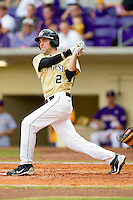 Mark Rhine #2 of the Wake Forest Demon Deacons follows through on his swing against the LSU Tigers at Alex Box Stadium on February 20, 2011 in Baton Rouge, Louisiana.  The Tigers defeated the Demon Deacons 9-1.  Photo by Brian Westerholt / Four Seam Images