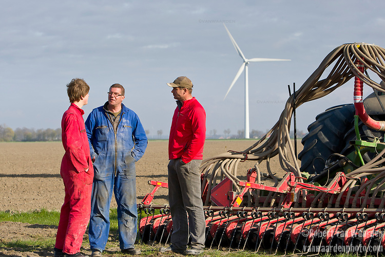 Ralph De Clerck, (m) and Stephan de Clerck (r) speak with Ralph's son (l) during an afternoon on the farm in Swifterbant, the Netherlands. The de Clerck family has been farming wind energy for over a decade. Together the two brothers, Stephan and Ralph are producing over 8MW of wind energy and selling it to the grid. The wind energy is an important crop that allows them to diversify their product. They continue to farm their land, planting potatoes and the wind mills run in the background.