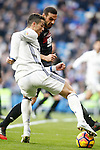 Real Madrid's Cristiano Ronaldo (l) and Granada CF's David Lomban during La Liga match. January 7,2016. (ALTERPHOTOS/Acero)