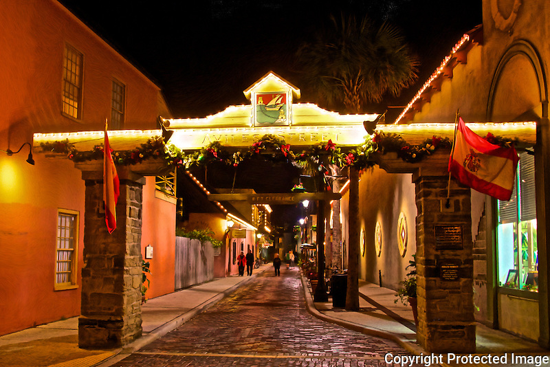 The Aviles Street Arch in historic downtown St. Augustine, Florida. Aviles Street is the nation's oldest platted street. It is decked out with hundreds of white lights for St. Augustine's Nights of Lights celebration.
