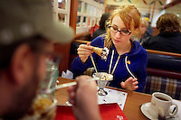 Pussy Venom and her boyfriend Kevin at a Friendly's for ice cream after a roller derby bout in Wilmington, Massachusetts.