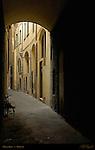 Florentine Medieval Street Arch between buildings Florence