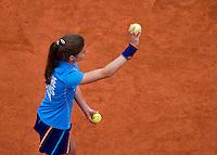 France, Paris, 26.05.2014. Tennis, Roland Garros, Ballgirl throwing a ball at a player<br /> Photo:Tennisimages/Henk Koster