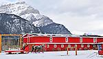 Bright red barn and horse drawn sleigh in Banff Alberta